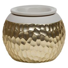 Glamorous and elegant, consider it a statement piece for your nightstand or console. Porcelain with a hammered-effect, metal-plated finish.
