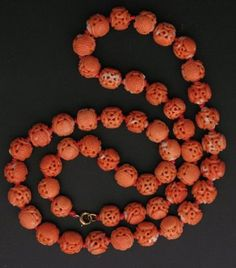 Chinese Carved Coral Necklace~~ This exquisite 19th century salmon coral necklace is composed of 51 hand carved coral Chinese beads, (carved on two sides with the long life symbol). Hand knotted on a silk cord, it has a 14KY gold clasp.