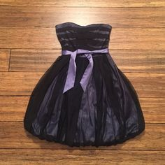 BCBGeneration strapless dress, worn once! Purple strapless dress with black mesh overlay.  Sweetheart neckline, purple tie at waist. Elastic back, so dress has some give. Only wore once for a few hours! BCBGeneration Dresses Strapless