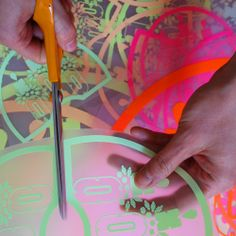CUTTING THE VINYL PRINTS   I design all my prints on ILLUSTRATOR then cut them using a Roland plotter in super bright vinyl. I combine these bold prints with hand cut and sewn applique panels. The applique pieces are cut from lovingly sourced vintage and unusual fabrics. The end result is a well crafted and UNIQUE, sTYLISH and cOLOURFUL product.