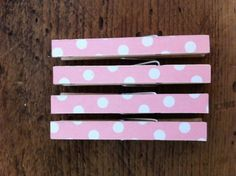 mod podge clothespins... use these to make picture frames even cuter!