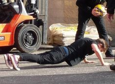 Louis doing push ups because he lost at football and the flipping the middle finger