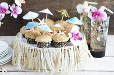Host a Hawaiian-themed celebration with tropical decorations, food and refreshments.
