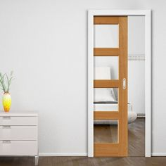 Single Pocket Humber Oak sliding door system in two size widths with Clear Glass. #internalpocketdoors #contemporarydesignroomdividers #oakglazedpocketdoors
