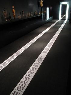 Interesting floor graphics designed to show the way - could do something similar with a crime scene tape graphic on the floor Wayfinding Signage, Signage Design, Booth Design, Floor Signage, Layout Design, Design Design, Exhibition Display, Exhibition Space, Museum Exhibition