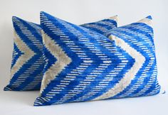 It has,  :: ts made of silk ikat  :: The cover is zipped on the back.  :: Back fabric :: This listing is for pillow cover only without insert/filler.  ::