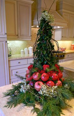 Ivy topiary with pomegranates and pine