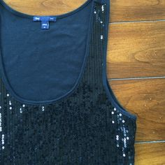 FINAL SALE GAP sequin tank. Like new. M Vamp up your outfit with a little shine in this GAP sequin tank. Front is full sequin and back is cotton. Same fabric as a plain GAP tshirt. I don't think this was ever worn. No sequins missing. Has stretch and a flattering scoop neck. Cute with jeans or dressier or under a suit. Black - Medium GAP Tops Tank Tops
