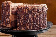 A rich, dense chocolate cake recipe with a whipped fudge filling and a milk chocolate buttercream frosting.