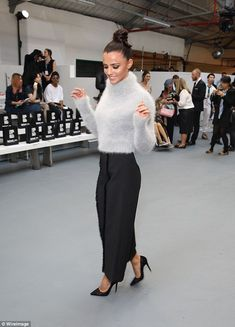 Cuddly: The beauty donned the fluffiest of jumpers, a pale grey polo-neck knit, which she teamed with ankle-length black culottes