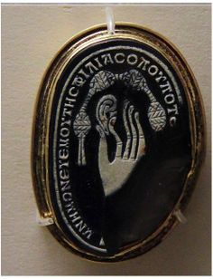 Cameo made from a pebble, Roman, 2-3c AD, showing a hand pinching an earlobe, Greek inscription : 'Wherever you are, remember me (and) the love (I bear you)'