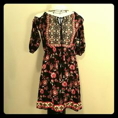 Urban Outfitters Cold Shoulder Boho Dress NWT Channeling a bohemian aesthetic, this Staring At Stars floral print dress for Urban Outfitters has 3/4 sleeves and a pull through, beaded end tie neckline that allows you to get the perfect cold shoulder fit.  Elastic cinched waist and cuffs.  The perfect dress for that free spirit! Urban Outfitters Dresses