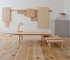 Peg modular furniture system collapses to hang on the wall
