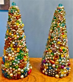 A pair of Christmas trees made from vintage jewelry…