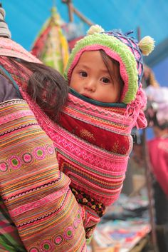 """Cute Hmong child  """"Flower Hmong"""". Wednesday weekly market in Cao Son. Northwest Viet Nam."""