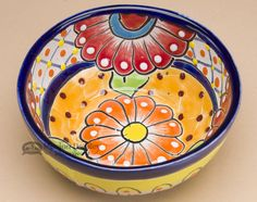 This hand painted Talavera pottery salsa bowl is the colorful ceramic of southern Mexico. With intricate patterns and brilliant colors, Talavera ceramic pottery is beautiful and adds life to any setti