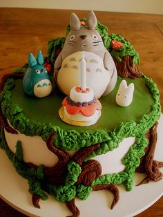 Totoro birthday cake!  DIY Fabric Pom Poms  You can find everything fun and fabulous about being a parent on Modern Parent Online! www.modernparentonline.com