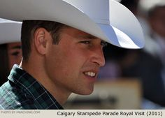 Here's William and Kate watching the Calgary Stampede Showband at the 2011 Calgary Stampede Parade