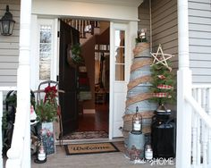 Galvanized tree and adorable front porch:  Finding Home Front Door Entrance
