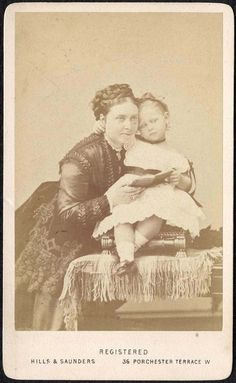 Victoria, Princess Royal and Crown Princess of Prussia, posing with her daughter, Princess Charlotte of Prussia.