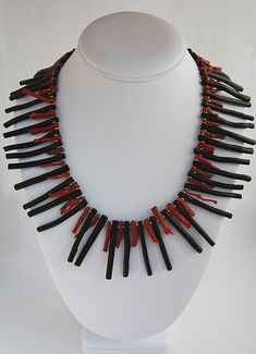 Coral Necklace / Red and black coral sticks with brass spacers.