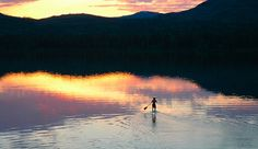 paddleboarding at sunset