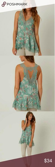 NWT Free People Bellflower Tank Top 💎Color: Seaglass Combo 💎Light & Breathable  💎Perfect for the Summer Heat 💎Beautiful Lace Trim 💎If you have questions just ask :)  💎OFFERS WELCOMED 😄😄😄 Free People Tops Tank Tops