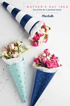Mother's Day gift idea — give flowers with a twist! Use pretty, printed gift wrap to give any bouquet a fun little touch. Look for cute styles like this metallic bumblebee pattern, navy stripes or tonal prints (blue polka dots on blue)! Visit Marshalls today for the paper that's perfect for Mom.