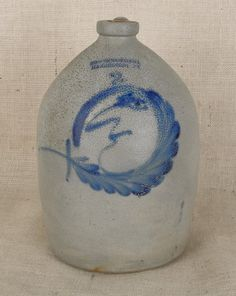 This used to be in my collection, but it broke into several pieces when I shipped it back to the US from Germany.  Two-gallon stoneware crock, 19th c., impressed Cowden and Wilcox Harrisburg, Pennsylvania, with cobalt man in the moon decoration, 13 1/2'' h.