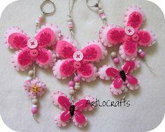 Pink felt butterflies with pony beads.  Cute girly craft idea!