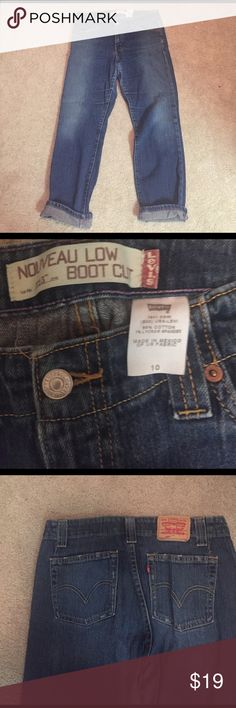 Levi's nouveau bootcut size 10 VGUC cute bootcut jeans fit like boyfriend jeans measurements in inches and approx. inseam in cuffed approx 29 inches rise would say high at 12 inches hip to hip 18 inches Levi's Jeans Boyfriend