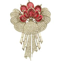 "A classic Pennino floral bouquet fur clip, the petals and ribbons set in rhodium with clear pave and baguette rhinestones. The ""flowers"" are faceted"