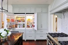 Oh...what I wouldn't do with this kind of space in my kitchen/refrigerator! built in refrig/cabinets
