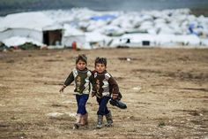 All sizes | Syrian boys, whose family fled their home in Idlib, walk to their tent, at a camp for displaced Syrians, in the village of Atmeh, Syria, Monday, Dec. 10, 2012 | Flickr - Photo Sharing!