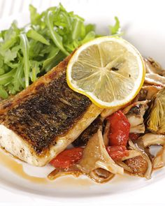 Pan-Roasted Striped Bass with Roasted Artichokes, Mushrooms, and Tomato Marmalade