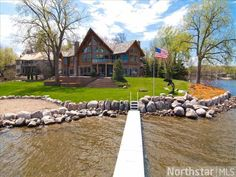 The most admired home on Crystal Lake. Beautiful custom home positioned on a point with 200+ feet of lake frontage. Spectacular lake views and views of Buck Hill. The gorgeous finishes and unique architectural details make this home a true work of art.