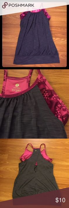 Old navy workout tank Pink patterned bra is attached. This top is super light and breathable. Love it but does not fit anymore. Selling the same top in purple if you want to bundle them! Old Navy Tops Tank Tops