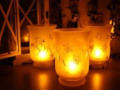 Flameless Votive LED Candles with Remote: Set of 3 Glass Jar Christmas Pattern ORANGE TREE TRADE,http://www.amazon.com/dp/B001PA1M1K/ref=cm_sw_r_pi_dp_Gk0vtb0R9X1PY0N1