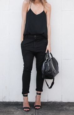 MINIMAL + CLASSIC: modern legacy. black top, pants and sandals.