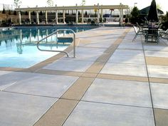 Even uncolored concrete can be decorative! This pool deck was installed by DCC member, Colorado Hardscapes, with uncolored concrete featuring bands in an alternate Sandscape finish to give it pizazz. Swimming Pool Images, Swimming Pools, Pool Liner Replacement, Pool Liners, Pool Picture, Paved Patio, Concrete Pool, Backyard Makeover, Pool Decks