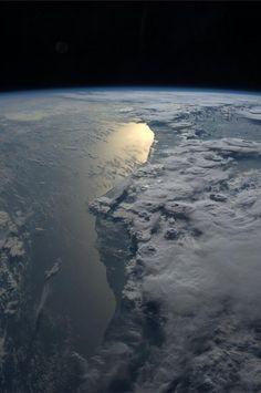 """""""Beautiful storms over Ghana. October 8"""", Astronaut Karen Nyberg."""