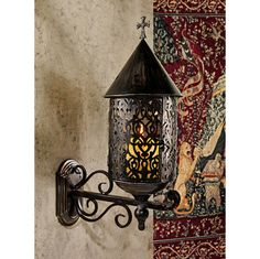 Add European flair to your castle's entryway with our exclusive Gothic candle sconces. Dramatic shadows will dance through the pierced aged metal enclosure that cages the flames nestled within these functional works of decorative wall art. Especially impressive lining a hallway or flanking a fireplace, our Medieval masterpieces boast a Gothic cross crown. Candle not included.