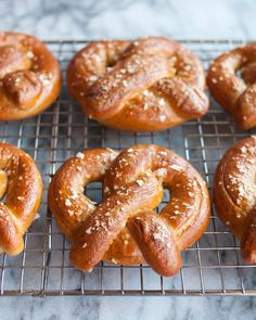 I have so many good memories of soft pretzels: a cold afternoon my first time in New York, Red Sox games at Fenway Park a few years later, a fantastic restaurant in San Francisco that serves them as an appetizer with cheese dip. In fact, it was a recent visit to this restaurant that reminded me of my deep and abiding love for this salty, chewy, soft-centered bread — and how, once upon a time, I'd even made them myself. Soft pretzels aren't that hard, really. They are made with a simple dough…