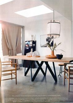 Living Etc Magazine -  April issue - UK Cartesio Table design Busetti Garuti Redaelli - This angular black base gives a chunky wood table a contemporary twist