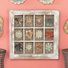 flowers from different sea shells. @meganspalding this would be cute for your bathroom