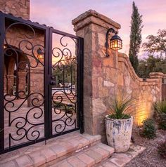 Beautiful gates and stone wall leading to courtyard