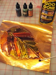 alcohol ink on copper. Remove drifting ink with a Qtip and Goo-gone