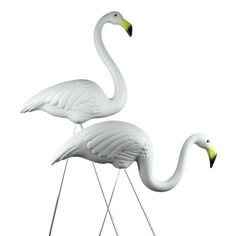 Pair Plastic Snomingo White Flamingos ~ Original Don Featherstone Design ~ Made in USA! by Union Products. $24.89. Includes 4 Steel Legs. Don Featherstone Signature on Bottom. Packaging: Plain Plastic Bag. Pair Plastic White Flamingo Lawn Decorations. Made in the USA!. Pair of Classic Plastic White Flamingos, affectionately known as the Snomingo. Set includes one standing and one feeding bird made from sturdy white plastic. Standing flamingo measures 35 inches tall overall, and a...