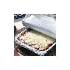 """""""Spaghetti is layered like lasagna with ricotta cheese, Italian tomato sauce, and mozzarella cheese for this fun and tasty baked pasta casserole."""""""