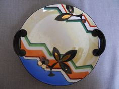 """Stunning Bold Graphic Antique Art Deco handled serving plate, circa 1930s. It is marked """"Meito China Hand Painted Made in Japan"""". It measures about 8 inches across at its widest, including the little handles."""